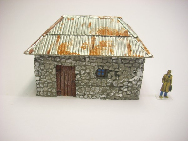 1:76  STONE BUILDING WITH SHEET METAL ROOF