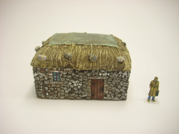 1:76  STONE CROFT WITH GRASS ROOF AND NET.