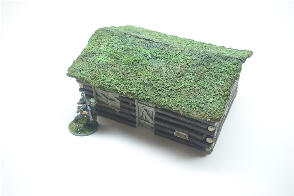 EASTERN FRONT LOG CABIN with turf roof