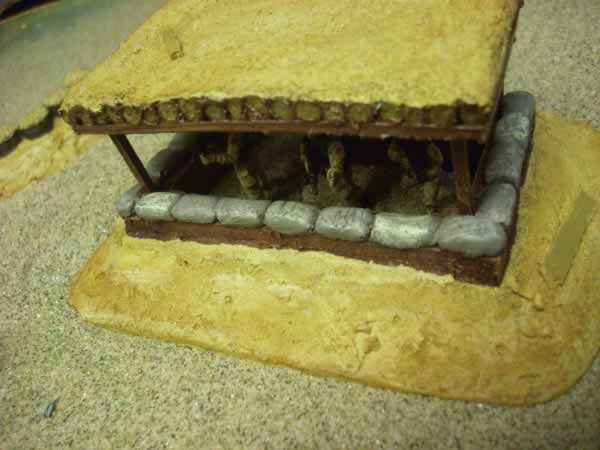 LARGE LOG COVERED SANDBAGGED BUNKER