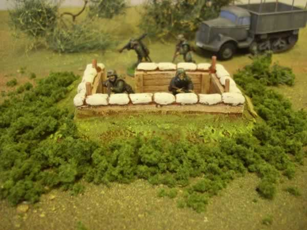 1:56  LARGE LOG COVERED SANDBAGGED BUNKER